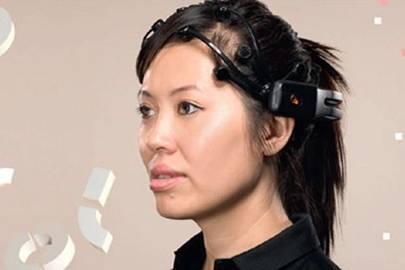 Tan Le wearing Epoc headset