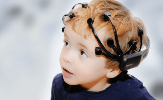 child wearing emotiv epoc+