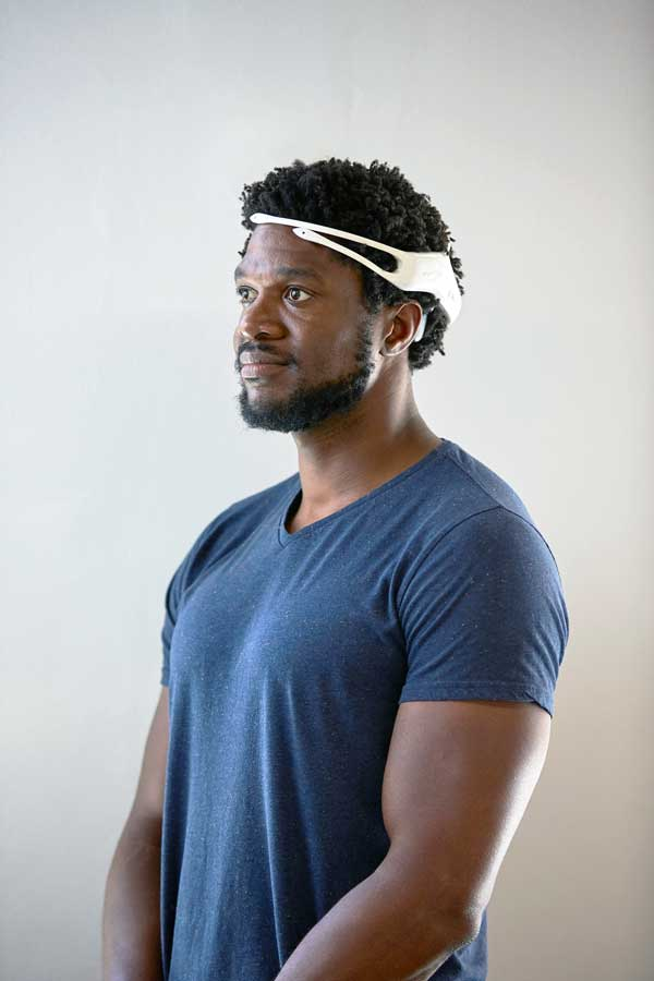 a man wearing Emotiv insight headset brain waves measuring data hardware neurotech